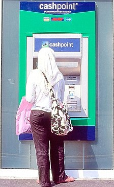 A Muslim student at a cash machine