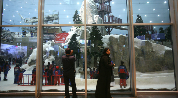 A visitor takes a photograph at Ski Dubai, an indoor ski slope in a shopping mall in the emirate.